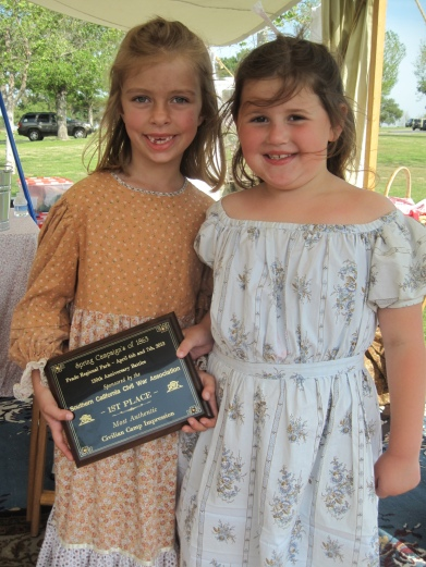 What makes an award look even better? Two cute little girls holding it!